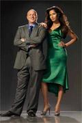 She shouldn't wear heels when she stands beside him.