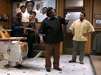 Ice Cube looks on in frustration as the hilarious Cedric the Entertainer steals yet another scene.