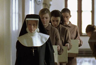 Sister Mary nicely avoids the embarrassment of wearing the same outfit as the other girls.
