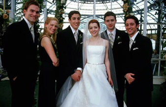 The cast of American Wedding fakes smiles about Knocked Up's performance.
