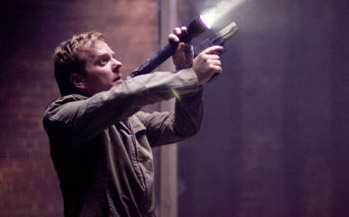 Gee, I've never seen Kiefer Sutherland hold a gun before.