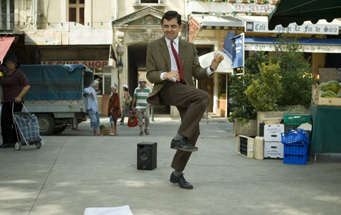 Mr. Bean dances as he realizes the ridiculous amounts of money he has made...but not in America.