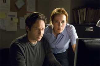 Mulder and Scully are not happy to see box office numbers on their computer.