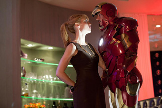 He says he's taller than her but she is (correctly) pointing out the suit adds a foot.