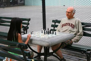 Alas, the Harvard sweatshirt doesn't make him a better chess player.
