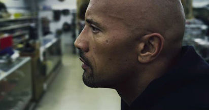 The Rock takes a thoughtful moment to consider a catchphrase as good as 'Boots to Asses'.