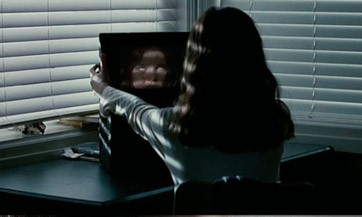 Is she Skyping herself? Oh! This is an evil twin movie. I get it.